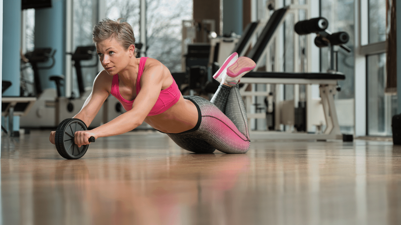 woman ab roller exercise
