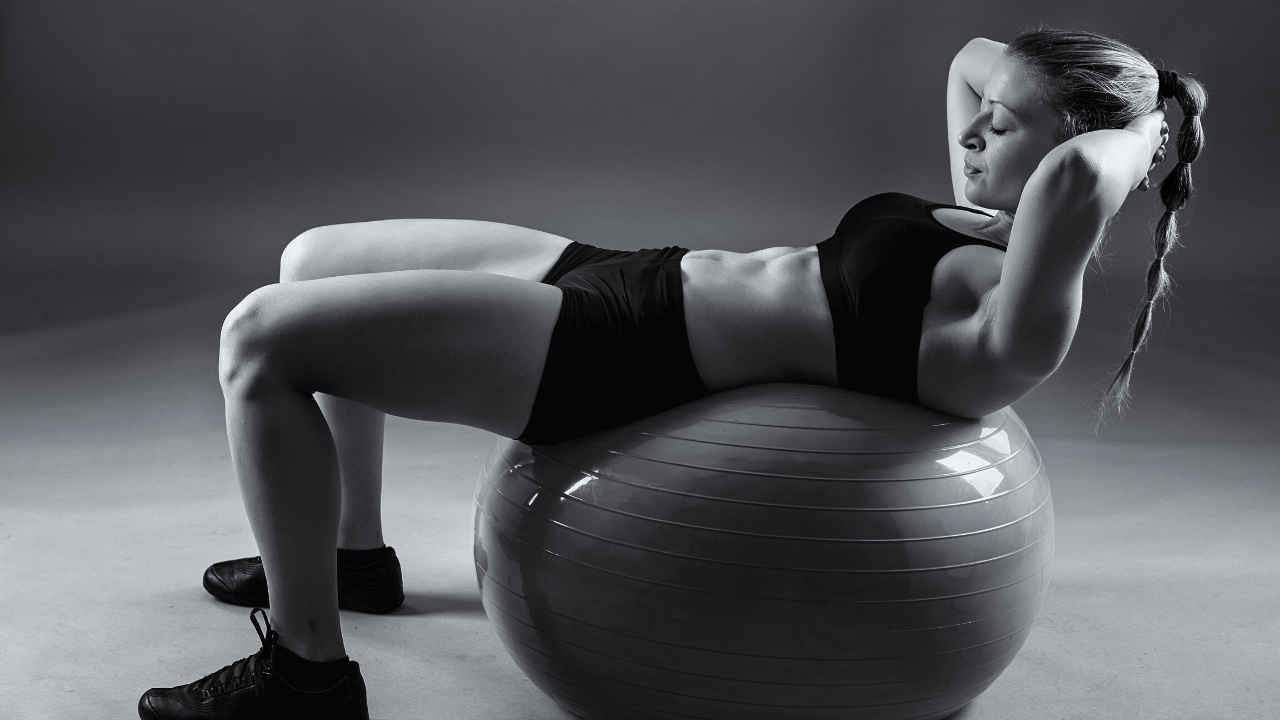 woman stability ball exercise