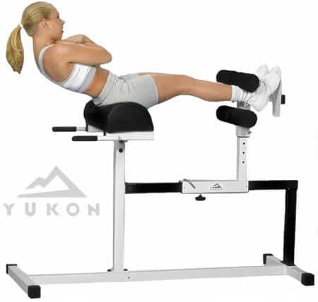 woman working out on glute ham raise machine