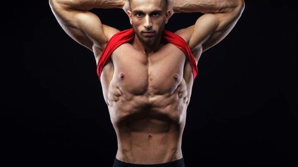 man doing stomach vacuum exercise