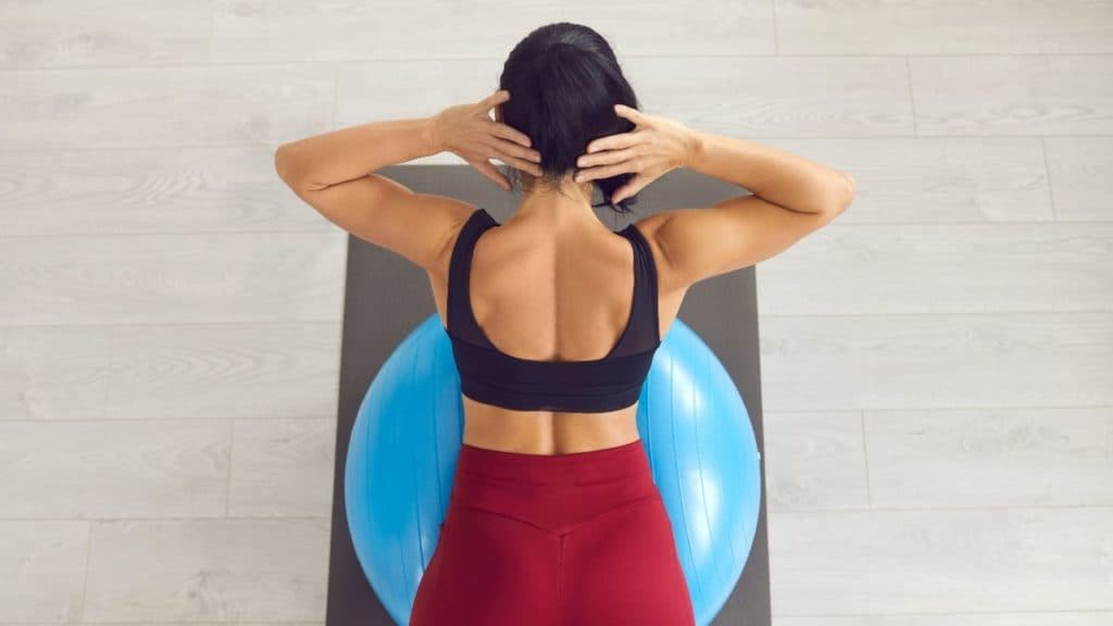 woman doing back extension on ball